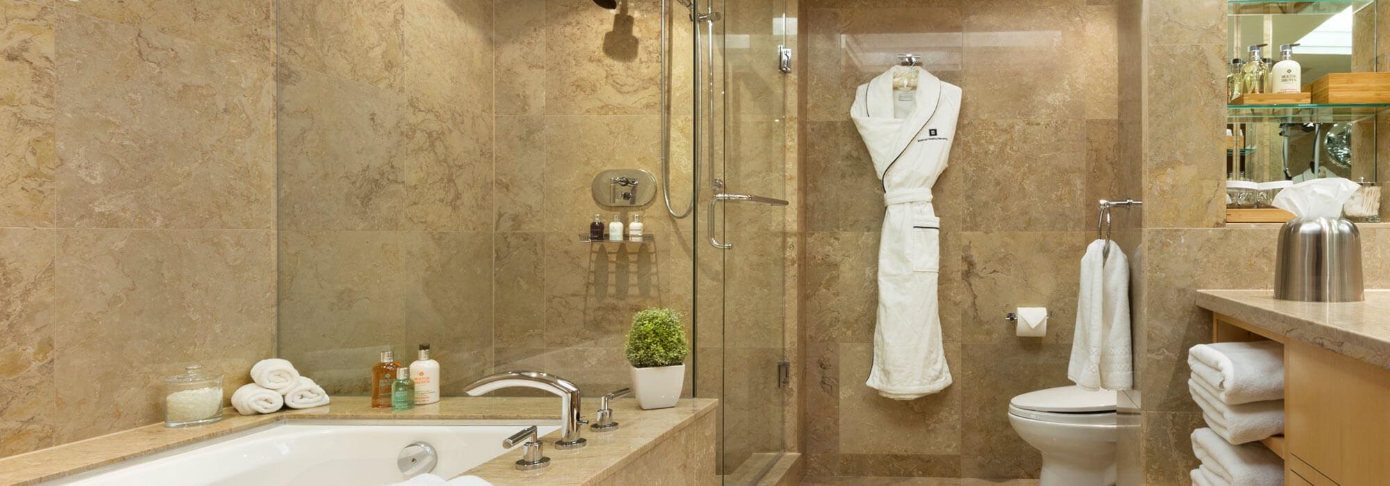 SoHo Hotel accommodations Sahara marble bathroom with heated flooring