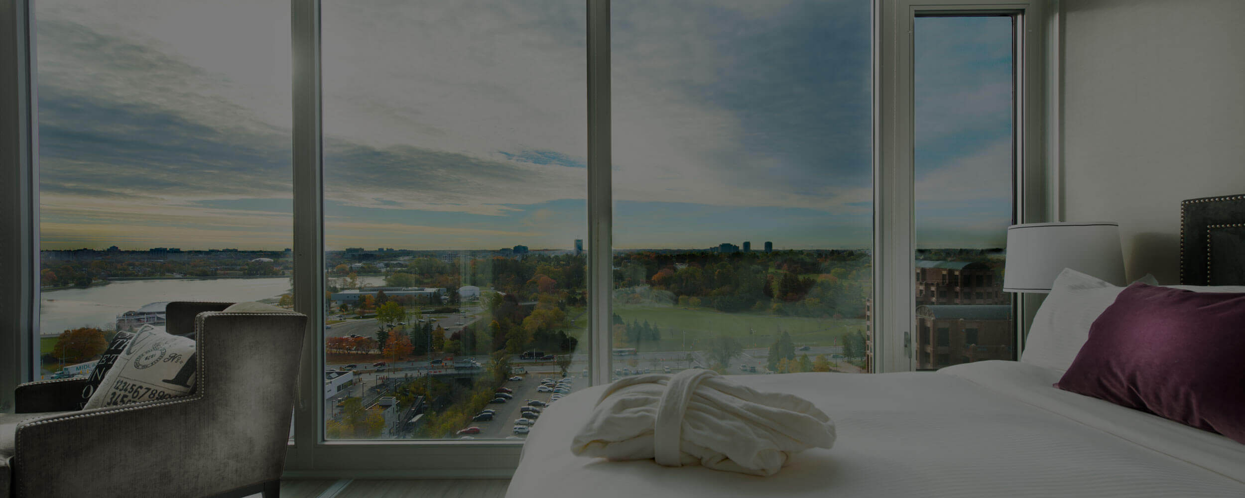 SoHo Champagne Residences in Ottawa furnished bedroom suite with Dow's Lake views