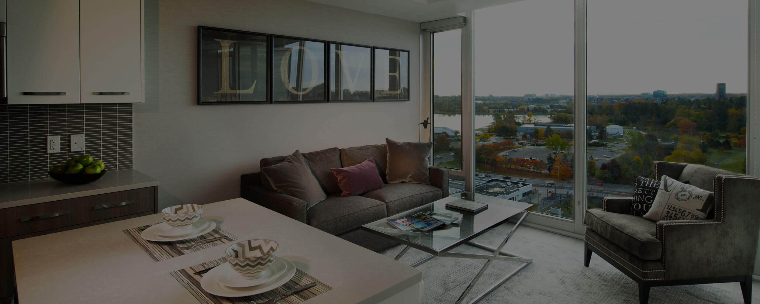 SoHo Champagne Residences in Ottawa furnished bedroom suite with living and kitchen and Dow's Lake views