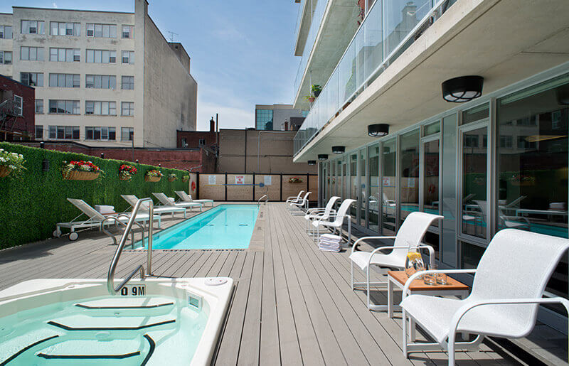 SoHo Lisgar Residences in Ottawa amenities outdoor lap pool, hot tub, and loungers