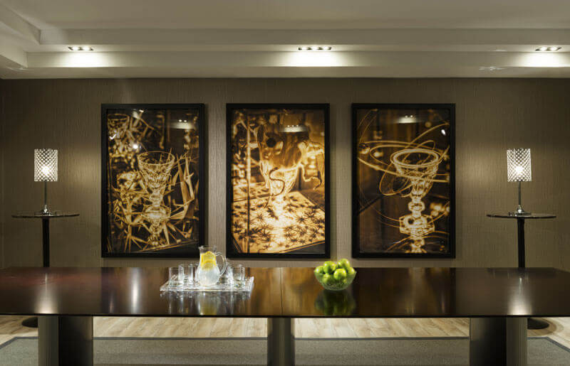 SoHo Champagne Residences in Ottawa amenities boardroom with original artwork