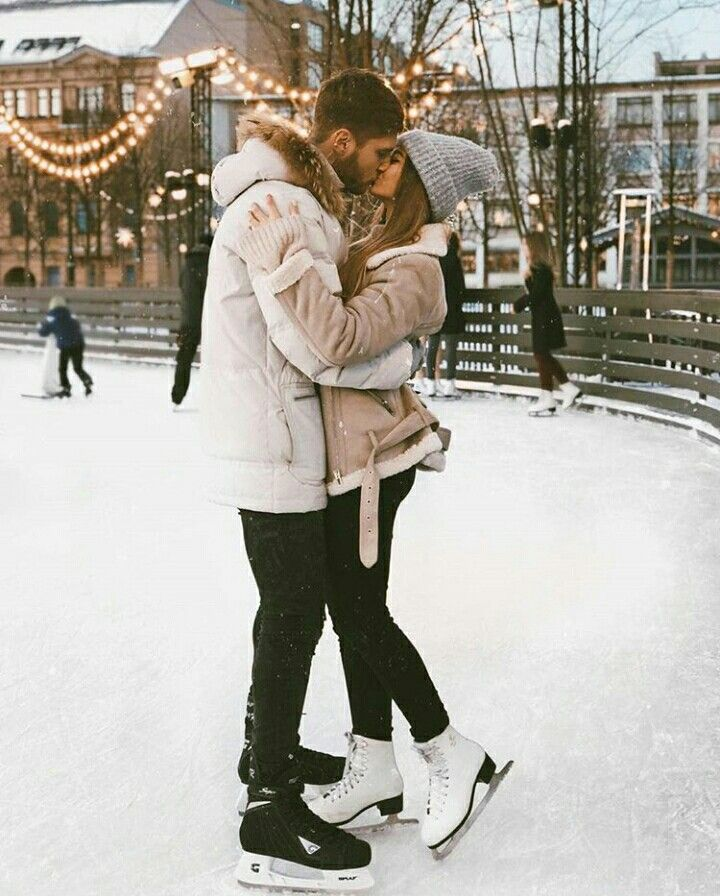 Couple kiss while skating