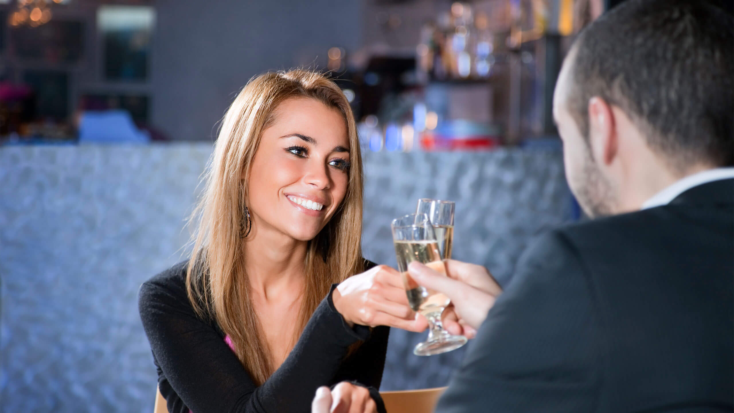 Couple cheering with glass of bubbly