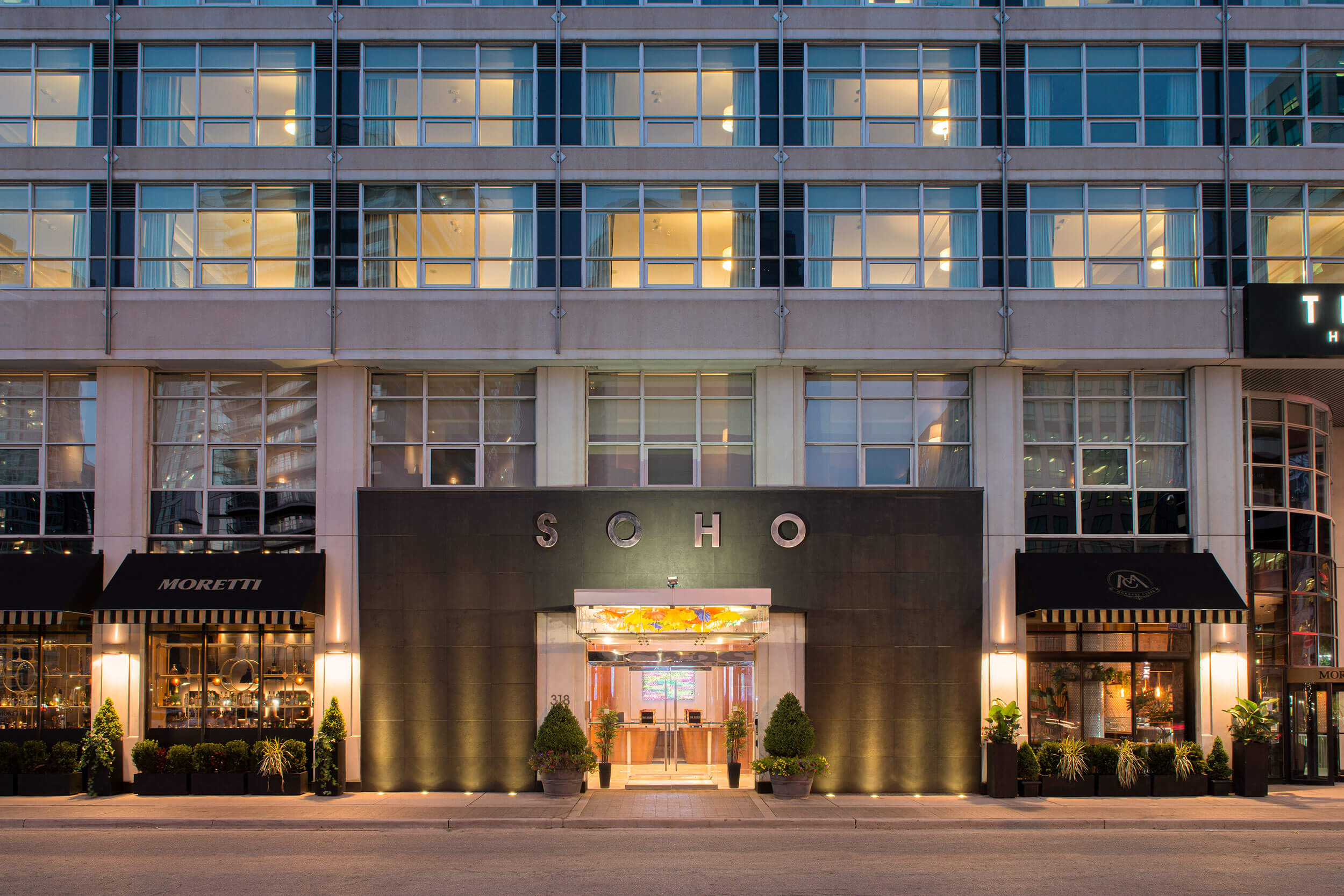 The Soho Hotel & Residences front entrance at dusk